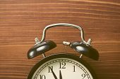 foto of analog clock  - the closeup of analog retro alarm clock - JPG