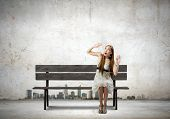 stock photo of scar  - Asian pretty scarred woman sitting on bench - JPG
