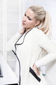image of herniated disc  - Young beautiful business woman has pains on her back  - JPG