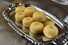 picture of mithai  - A tray full of popular indian sweet made with condensed milk - JPG