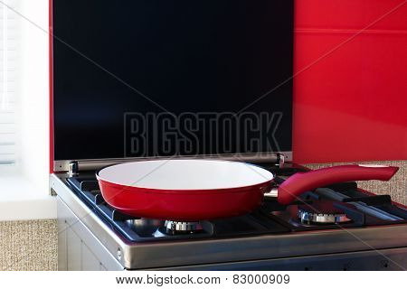 Red Frying Pan On A Gas Stove