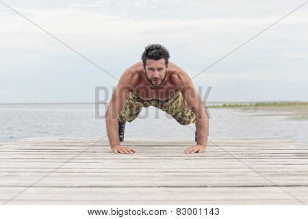 Athletic Army Doing Push Up Exercise At The Beach