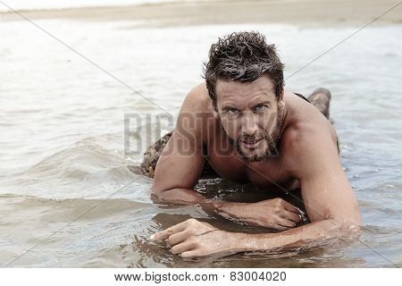 Handsome Shirtless Army Crawling At Sea Water