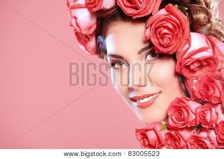 Beautiful tender girl with floral hairstyle. Roses. Cosmetics. Beauty, fashion. Spring and summer. Copy space.