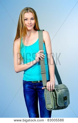 Portrait of a student girl with her school bag. Education.