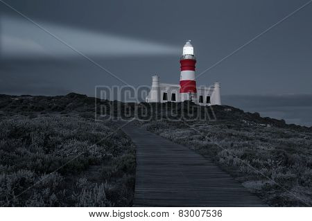 Lighthouse With Shining Light In Darkness And Dark Blue Clouds Artistic Conversion