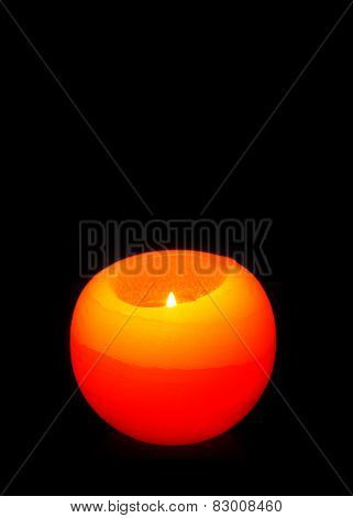 Orange Sphere Candle Isolated On Black