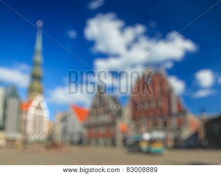 Blurred defocused background of european town - Riga Town Hall Square, House of the Blackheads and St. Peter's Church, Riga, Latvia