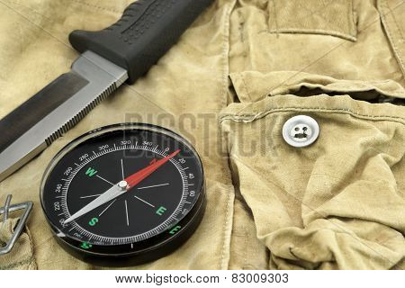 Knife And Compass On The Camouflage Bag