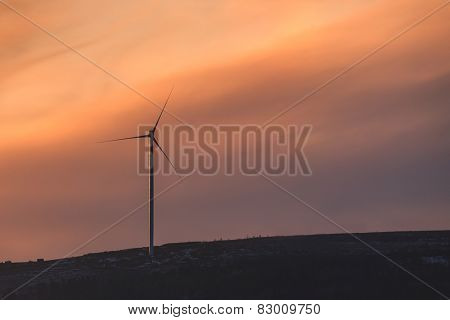 wind turbine on sunset background
