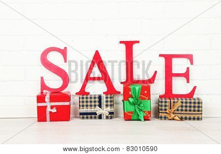 Sale with gifts on floor in room