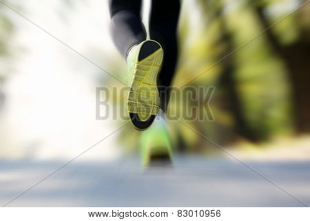 Runner feet on road, outdoors