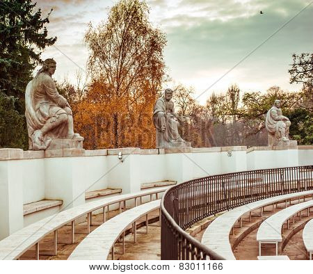 Statues of famous playwrights, amphitheatre in Lazienki Park (Royal Baths Park), Warsaw, Poland