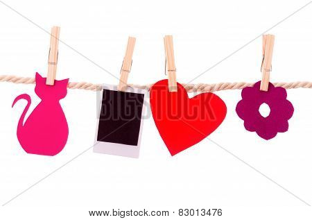 instant photograph and shapes hanging on a rope clothesline
