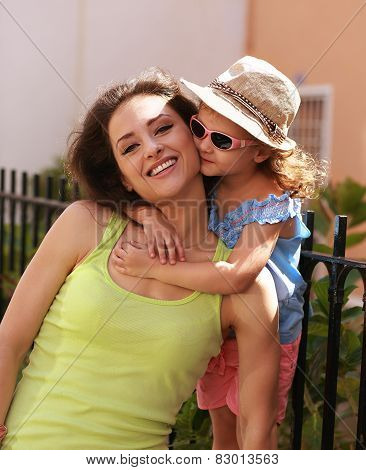 Happy Young Mother With Her Cute Kid Girl In SunGlasses