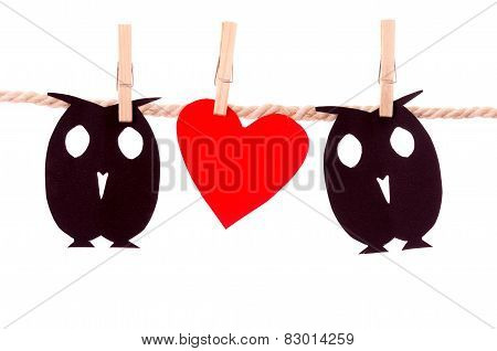 owls and heart paper shapes hanging on a rope clothesline