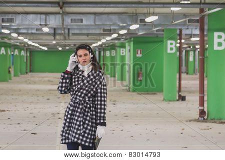 Beautiful Young Brunette Posing In A Parking Garage