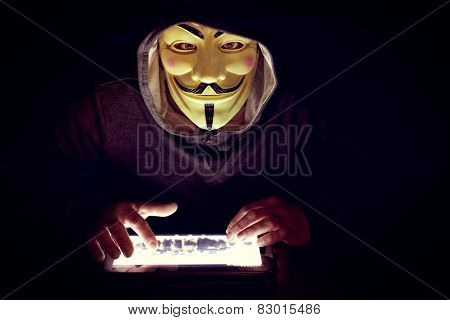 hacker with mask work to close terrorist sites