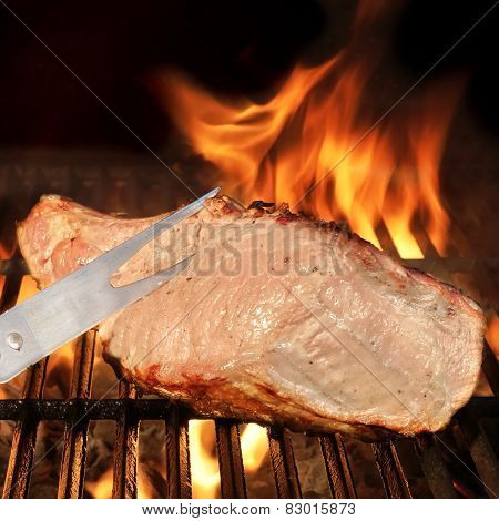 Fork And Grilled Meat On The Bbq Grill