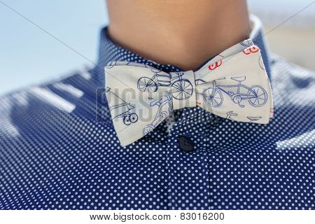 closeup of butterfly tie and blue shirt on caucasian man