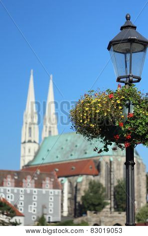 lamppost with flowers on the street