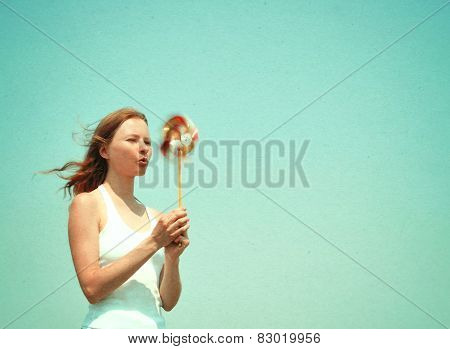 Young Woman With A Colorful Pinwheel