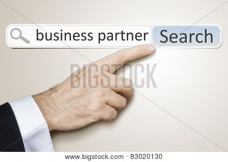 An image of a man who is searching the web for business partner