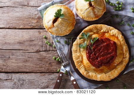 Australian Meat Pie On The Table, Horizontal View From Above