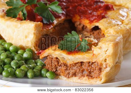 Pieces Of Meat Pie And A Garnish Of Green Peas. Horizontal Macro