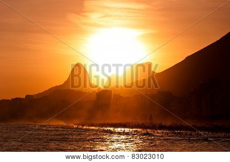 Sunset Behind Mountains in Copacabana Beach