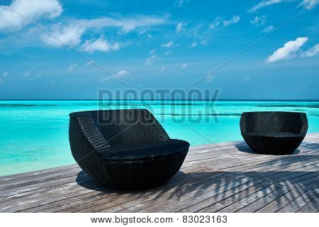 Tropical beach jetty at Maldives
