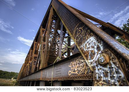 Graffiti On Old Rusty Train Bridge