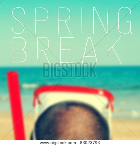 the text spring break written on a blurred image of a man with a diving mask and a snorkel