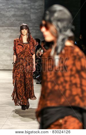 NEW YORK - FEBRUARY 12: A model walks the runway at the Nicholas K Fall/Winter 2015 collection during Mercedes-Benz Fashion Week in New York on February 12, 2015.