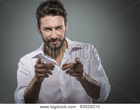 Fashionable Man Pointing At Camera