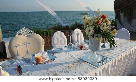 Luxury Table Setting With Candlestick By The Sea