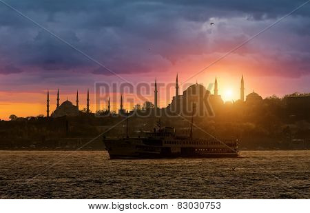Iconic Istanbul Silhouette and the ship during sunset