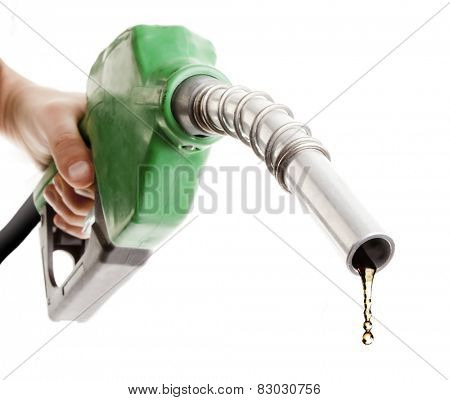 Male hand holding gas nozzle with one last drop isolated on white