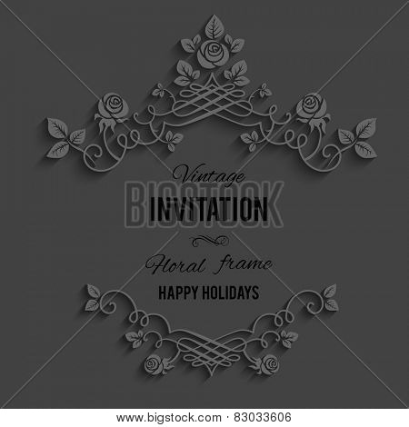 Elegant ornate floral frame on dark background.