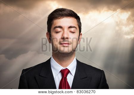 Portrait of a businessman relaxing outdoors