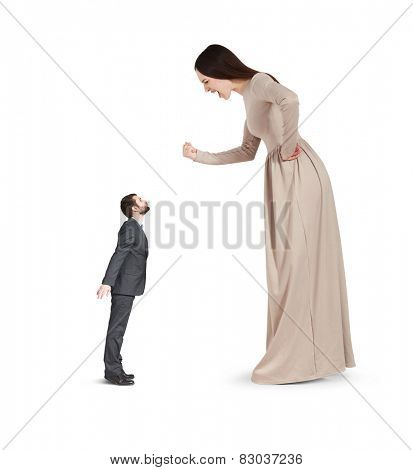 angry yelling woman waving fist and looking at small kissing man. isolated on white background