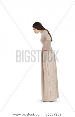 young beautiful woman in long dress staring at something. isolated on white background
