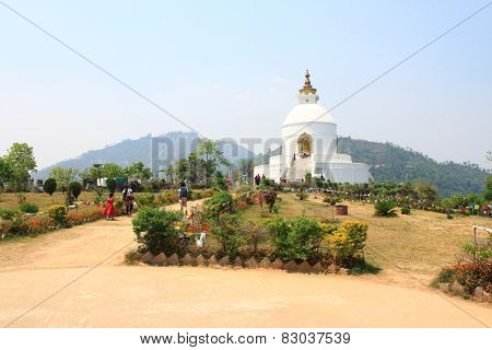 POKHARA, NEPAL - APRIL 2014 : People visiting Pokhara Shanti Stupa, World Peace Pagoda on 15 April 2014 in Pokhara, Nepal. Shanti Stupa was built in 1996 as a symbol of peace.