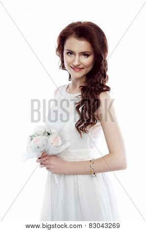 Studio Portrait Of A Beautiful Redheaded Woman With Evening Hairdo And Makeup