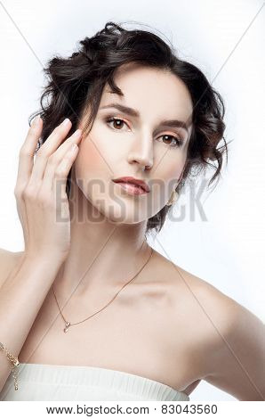Studio Portrait Of A Beautiful Brunette With Evening Hairdo And Makeup