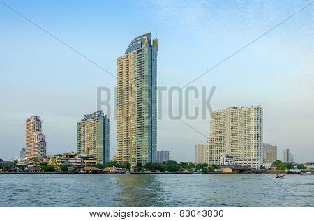 Modern skyscrapers and Chao Phraya river at sunset in Bangkok, Thailand