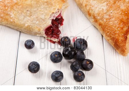 Sweet bake rolls on wooden table.