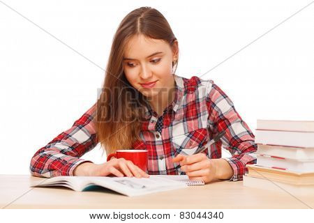 Young girl reading her textbooks