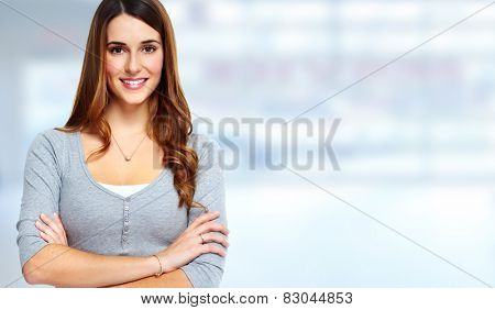 Young beautiful woman portrait over blue background.