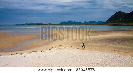 Paradise Beach Of Grunnforsfjorden, Lofoten And Sporty Woman